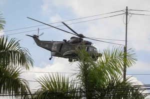 A Malaysian army helicopter flies in Cenderawasih near the area where the stand-off with Filipino gunmen and Malaysian security forces was taking place in Tanduo village on Tuesday. Malaysian security forces launched an assault on supporters of the Sultanate of Sulu engaged in a three-week incursion that has left 27 people dead.