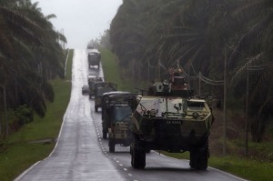 A convoy of Malaysian military vehicles travel in Felda Sahabat on Wednesday, near the village of Tanduo where Malaysia launched an assault against armed Filipino invaders.